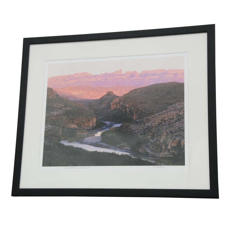 Original photograph, signed by Jim Bones. Photo depicts a gorgeous view of Sierra del Carmen in Mexico, as the Rio Grande runs through it. Titled