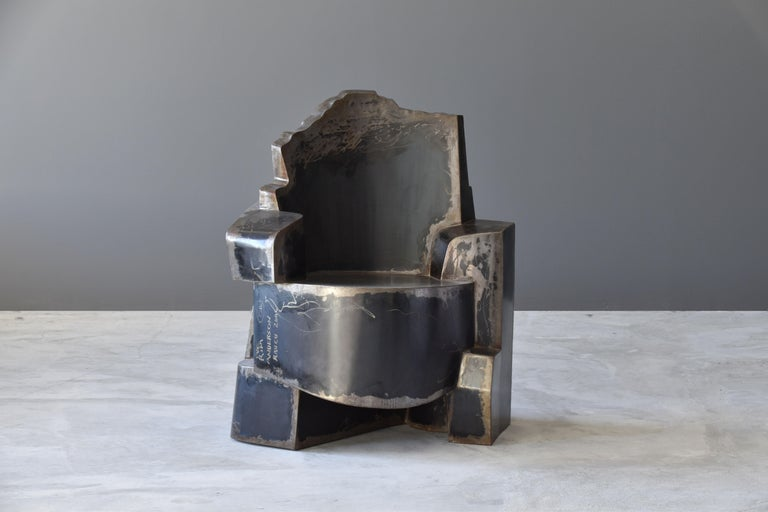 A contemporary welded metal armchair by American designer, Jim Cole. Titled