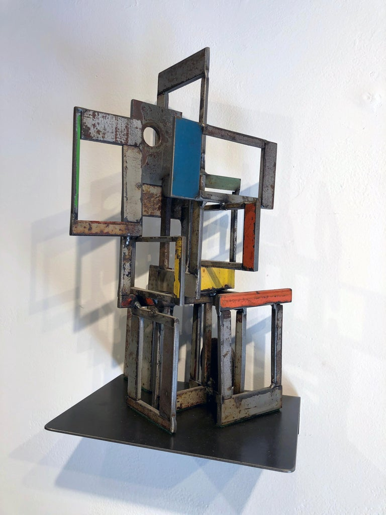 This is a welded steel sculpture made by Wisconsin based artist Jim Rose.  Using the same salvaged steel found in his renowned furniture, Jim combines various pieces of salvaged steel, taking advantage of the original painted and textured surfaces,