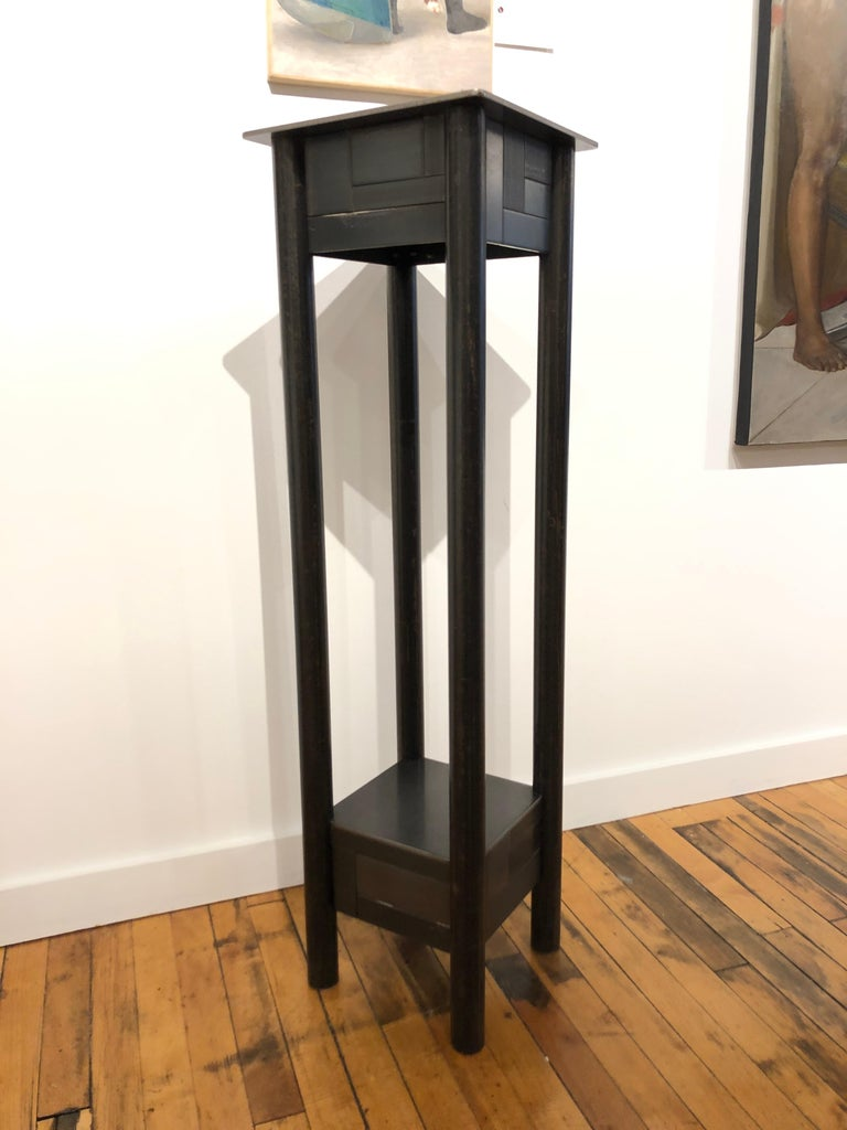 This is a welded steel industrial modern pedestal with a low shelf and a monochromatic skirt of steel panels arranged in a quilt pattern inspired by the quilts of Gee's Bend Alabama. Each piece of furniture is unique and made by Jim Rose. The skirt