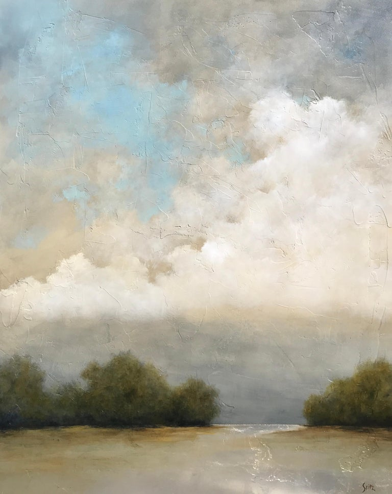 'Summer Haze' is a large acrylic and silver leaf on canvas landscape painting of vertical format created by American artist Jim Seitz in 2019. Featuring a silver, blue, green, brown and grey palette, the painting gives great importance to the sky,