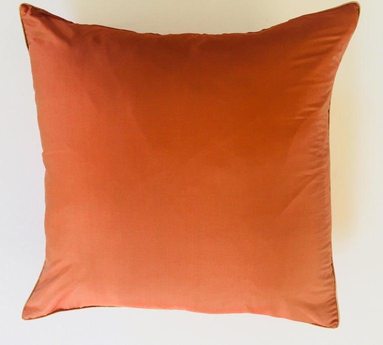 Jim Thompson lotus flower print large 22 inches square linen and silk decorative pillow in orange color. Elegant burnt orange designer large throw pillow with lotus design in front and plain silk orange backing. By American textile designer Jim