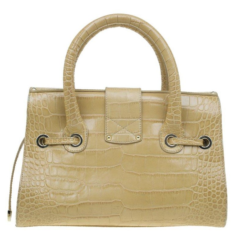 8a0cd7c7b4a6 This exquisite Rosalie satchel by Jimmy Choo is crafted from beige croc embossed  leather. It