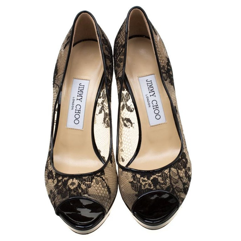 Jimmy Choo has come out with yet another pair of simple yet contemporary pumps. The pumps are covered in black lace and designed with peep toes, thin platforms, and 10 cm heels. Elevate your polished look by slipping into this pair.  Includes: