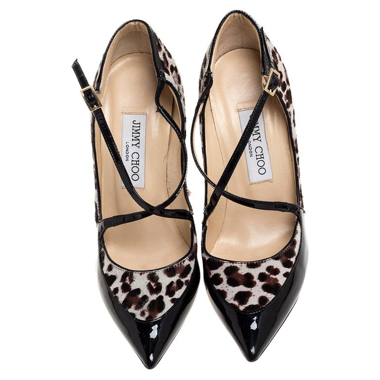 Stand out and strut in style with these Jimmy Choo pumps. Crafted from patent leather and pony hair, they feature crisscross straps on the vamps, pointed toes, buckle fastenings, and towering stiletto heels. Lined with leather, they are designed as
