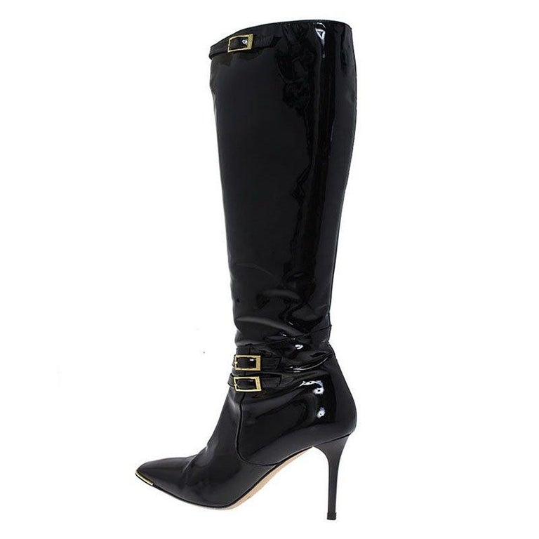 Jimmy Choo's style is inherently luxurious making it one of the most sought after brands. This stunner will has edgy charm and is sure to get you noticed. Crafted with the finest patent leather, this towering knee boots is characterized by the play