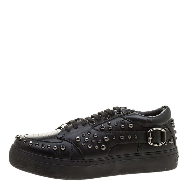 Comfort and high fashion come to you in a luxurious wave with this pair of sneakers from Jimmy Choo. They've been crafted from leather and styled with laces, buckles and gunmetal studs. Leather insoles and the brand label on the heels wonderfully