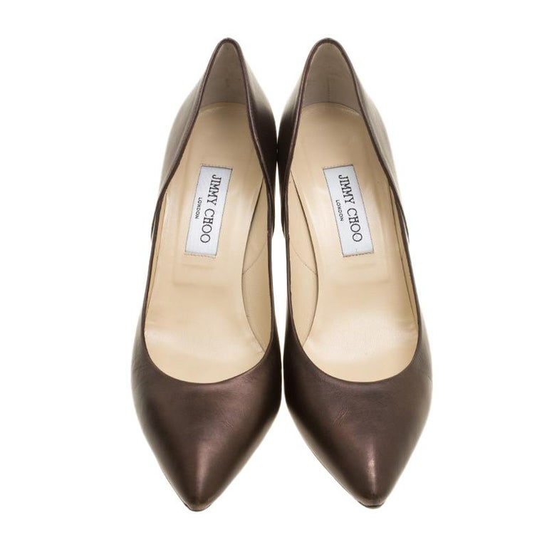 Make every occasion special by making this pair of Jimmy Choo pumps yours. Stand out from onlookers while donning this leather pair in brown. Lined with leather and shaped into pointed toes, these make an incredibly dressy pair.  Includes: The