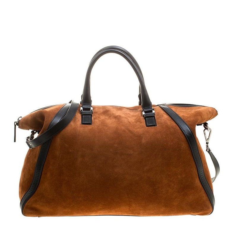 Want to take that weekend trip in style? This satchel from the house of Jimmy Choo ensures just that! Crafted from lush suede, this bag has a smart silhouette that can fit in all your essentials with ease while adding a touch of chic style to your
