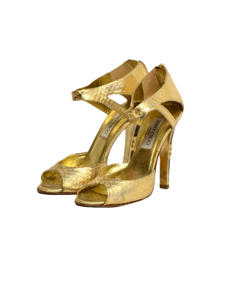Jimmy Choo Gold Python Sandals sz 38  Made In: Italy Color: Gold  Hardware: Goldtone hardware Materials: Python skin Closure/Opening: Back zipper closure Overall Condition: Good pre-owned condition, with light marks throughout skin, light wear to