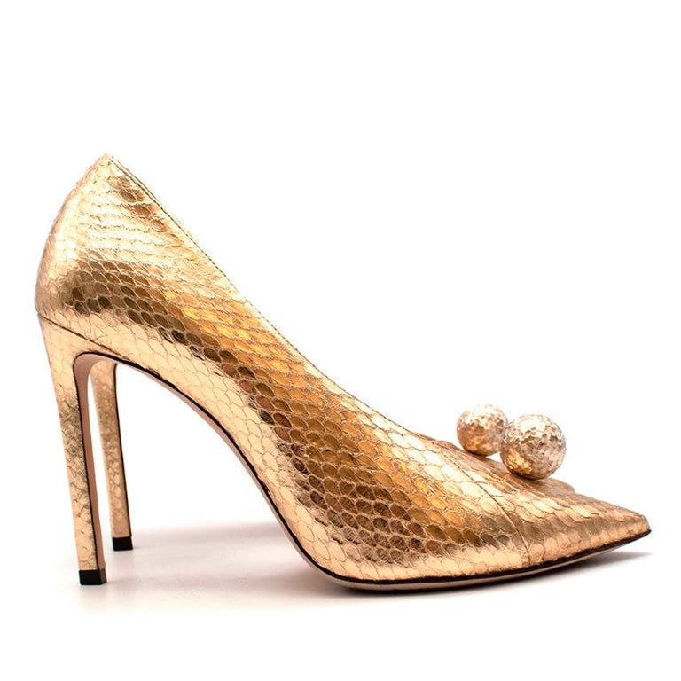 Jimmy Choo Golden Snakeskin Sandria 100 Embellished Metallic Leather Pumps   -Luxurious golden snakeskin  -Gorgeous spherical embellishment to the toes  -Open sides -Soft leather lining  -Stiletto heels   Materials: Main-snakeskin Lining-leather