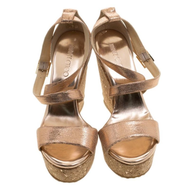 68a579bee0b Jimmy Choo Metallic Bronze Suede Portia Cork Wedge Cross Strap Sandals Size  39 For Sale. Coming from the house of Jimmy Choo