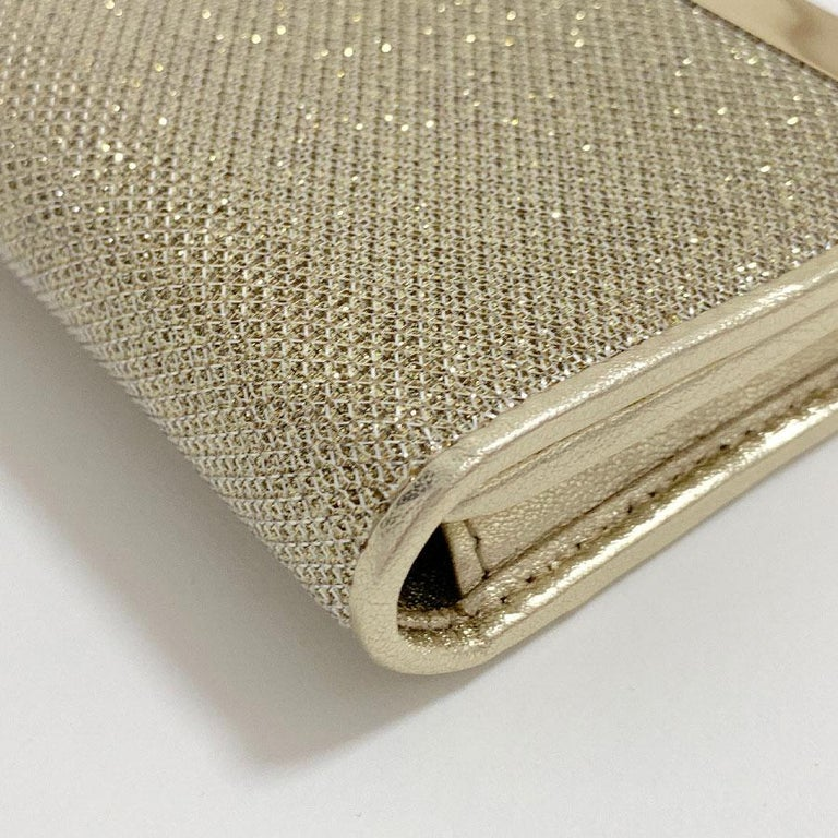 7b7d908a1a1a4 Milla JIMMY CHOO clutch bag in gold lamé leather This clutch is made of  shimmering golden
