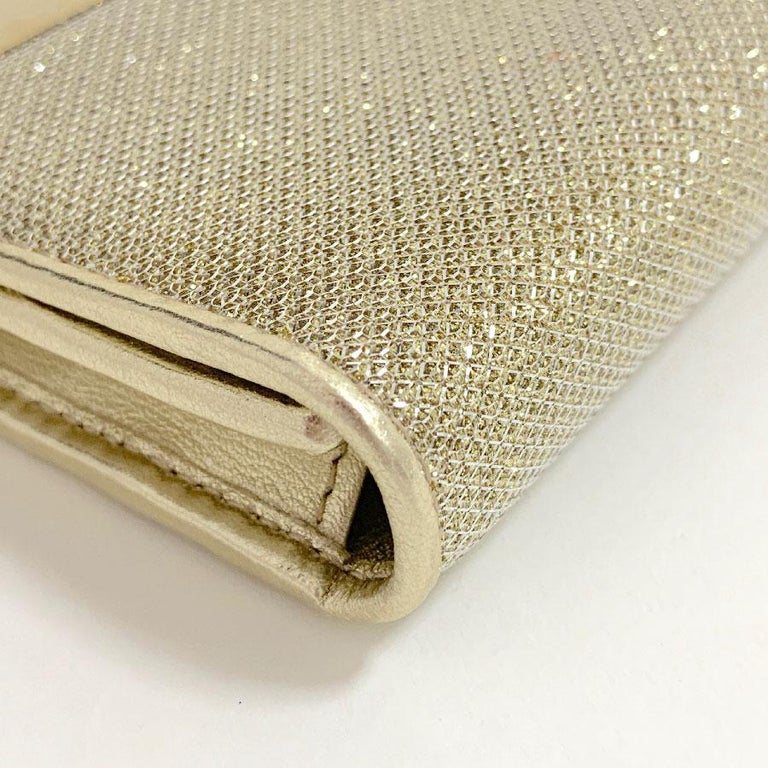Women's JIMMY CHOO Milla Clutch Bag in Gold Lamé Leather For Sale