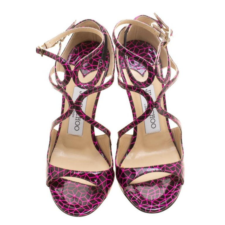We've fallen head over heels in love with these sandals! Possibly one of the most recognized designs from Jimmy Choo, the Lance is coveted by countless women. These ones are crafted from printed patent leather and styled in a strappy layout with