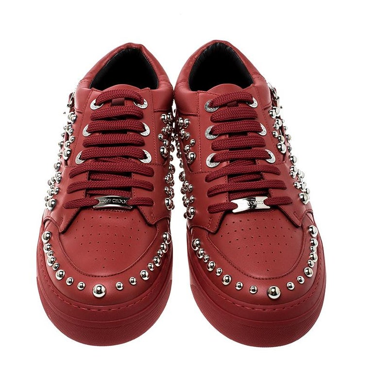 A pair of shoes to match your suave persona is here in the form of these red sneakers from Jimmy Choo. They've been crafted from leather and styled with laces, buckles and silver-tone studs. Leather insoles and the brand label on the heels