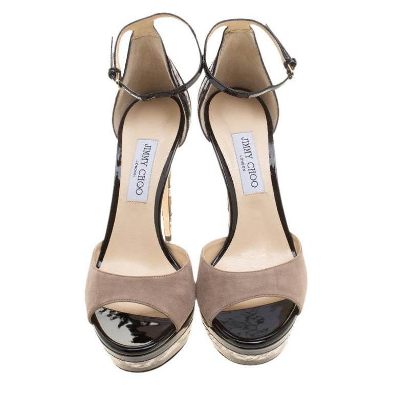 A dazzling diva needs a mesmerizing pair to complement her personality and these Jimmy Choo sandals are just the perfect choice. They've been styled with front suede straps, and a fantastic mix of snakeskin leather and patent leather on the