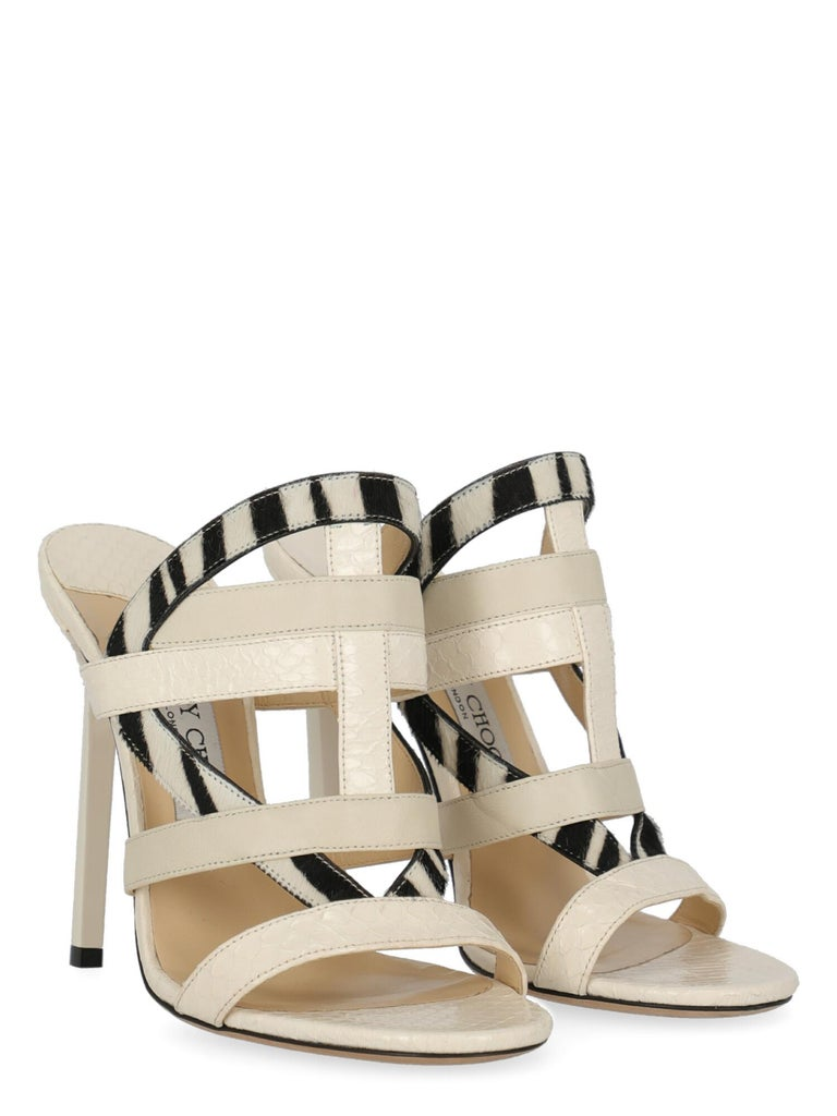 Product Description: Sandals, leather, other patterns, open toe, branded insole, tapered heel, high heel  Includes: N/A  Product Condition: Very Good Heel: slightly visible glue stains. Sole: visible signs of use. Insole: negligible generic