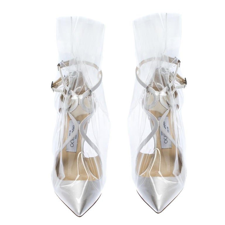 Jimmy Choo's Claire pumps designed in collaboration with OFF-WHITE are unique and every bit fashionable. They are crafted from white satin and feature pointed toes, cross straps at the front, buckle closure, and high heels. However, the TPU overlay