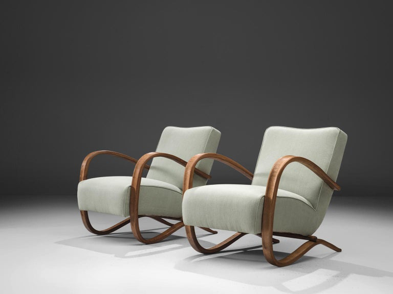 Pair of lounge chairs, in beech and fabric, by Jindrich Halabala, Czech Republic, 1930s. 