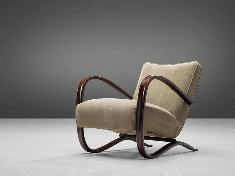 Jindrich Halabala, lounge chair, in beech and leather, by Jindrich Halabala, Czech Republic, 1930s.  This extraordinary Halabala chair is upholstered with a soft green leather upholstery in our upholstery studio. This chair has a very dynamic