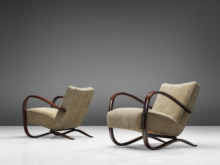 Jindrich Halabala, lounge chairs, in beech and leather, Czech Republic, 1930s.  This extraordinary pair of Halabala chairs are upholstered in a high quality leather in our upholstery studio. These chairs have a very dynamic appearance. Beautifully