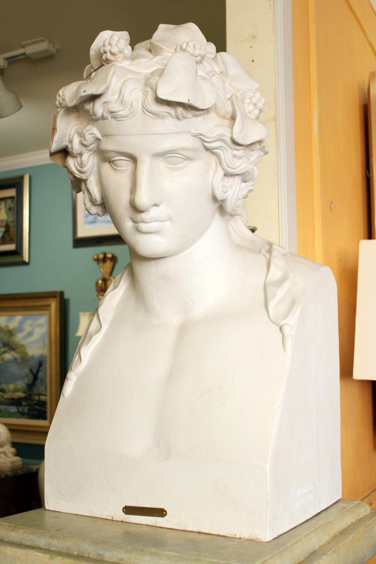 19th century cast iron and painted bust by noted Parisian foundry and retailer J.J. Ducel (1810-1878) and painted faux marble pedestal. The painted pedestal was made in the U.S. circa 1990. Dimensions of cast iron bust, height 29