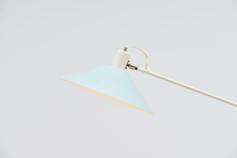 Fantastic first edition sculptural counter balance ceiling lamp designed by JJM Hoogervorst for Anvia Almelo, Holland, 1957. This fantastic lamp is an early 1950s edition, not compared to the later one with plastic details this edition is fully made