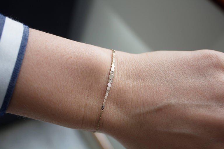 Hex Elements Bracelet handcrafted in London by jewelry designer Jo Hayes Ward featuring ascending hexagonal elements in warm-toned 18k white gold showcasing the artist's optically-phenomenal 3d-printed reflective finish and accented with four round