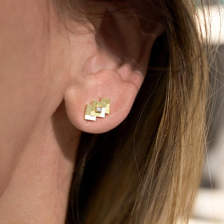 Parquet Stud Earrings handcrafted in London by jewelry maker Jo Hayes Ward in her signature-finished reflective 18k yellow gold featuring two princess-cut white diamonds. Stamped and Hallmarked.