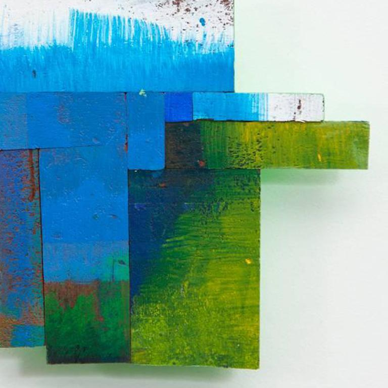 Joan Grubin sources paint-covered, protective pressed wood from a supply that amassed in her studio over a 13-year period.  She cuts and orchestrates these vibrant fragments, covered in accumulated layers of detrital brushstrokes, into collages that