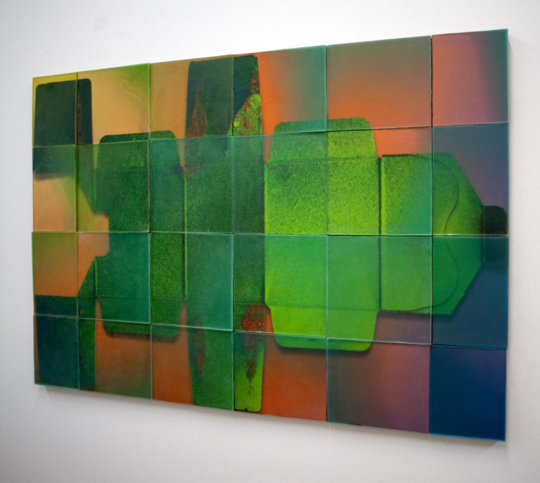 This wall piece is composed of 24 cast wax panels.  The abstracted image imbedded in the work is a photograph of the packing for Botox treatments. Vivid emerald green, vibrant orange, and violet blue tones are created in Joanne Ungar's unique poured
