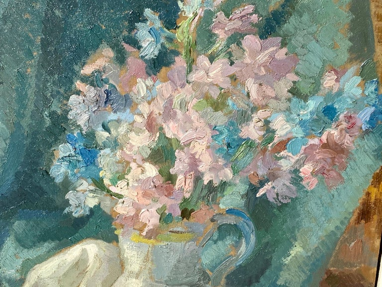 Magnificent impressionist still-life depicting a vivid bouquet of flowers in a vase next to a luxurious fan, created ca. first half of the 20th century, école de Paris.   The present painting could be depicting a corner in the dressing room of an