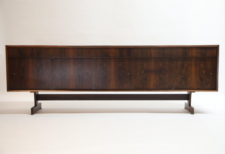 This incredible Joaquim Tenreiro sideboard possesses an incredibly vivid detail to the book-matched Brazilian Jacaranda rosewood grain. Designed and crafted in the mid to late 1950s, this piece still retains its original maker labels on the rear