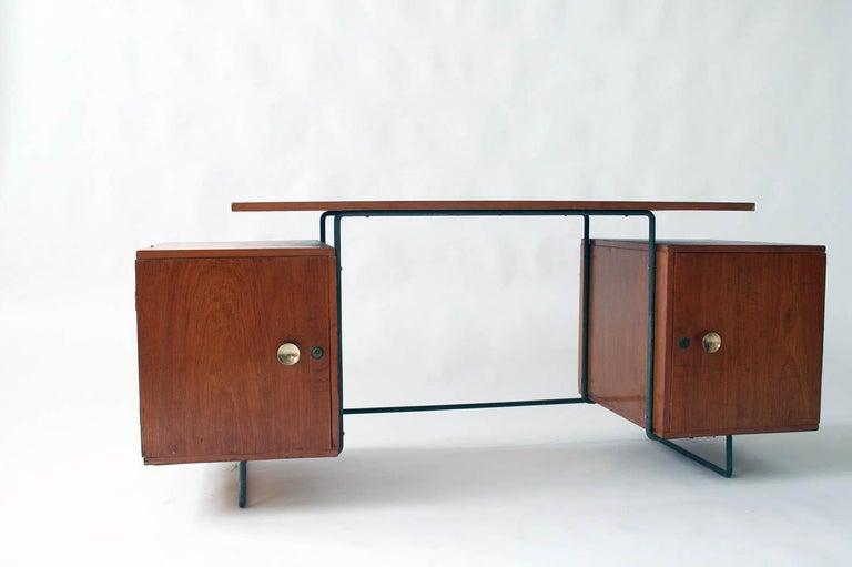 Joaquin Tenreiro iron and jacaranda floating top desk designed in 1954. Original label on underside.
