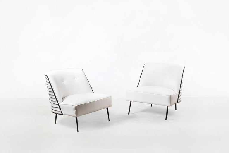 Pair of armchairs Manufactured by Tenreiro Moveis e Decoraçaos Brasil, 1959 Iron and upholstery.