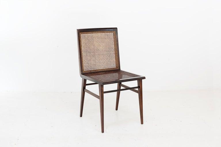 """Joaquim Tenreiro, (1906-1992)  Rare set of 8 chairs variant of the """"Cadeira baixa para quarto"""" Manufactured by Tenreiro Moveis e Decoraçaos Brasil, 1950 Jacaranda wood and cane From the archives of Side Gallery, Barcelona   Measurements 50"""