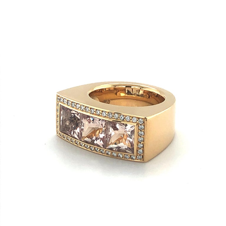 This expressive ring by the well-known German goldsmith Jochen Pohl is bold and comfortable at the same time. Perfectly crafted in 18 karat rose gold and set with three princess-cut morganites, together weighing 5.50 carats. Accentuated by 44