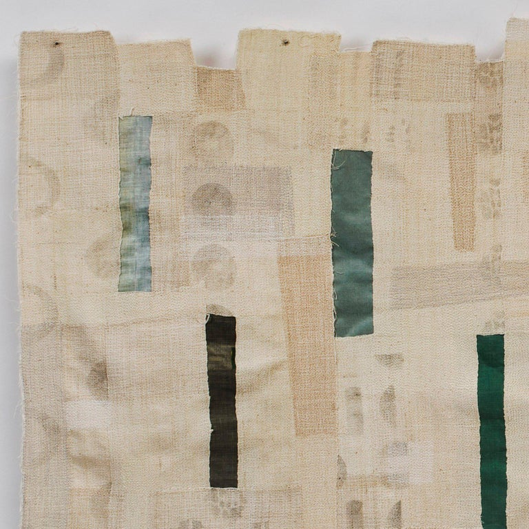 African backstrap woven cotton, bookcloth from discarded library books, stencils, thread, and mull.