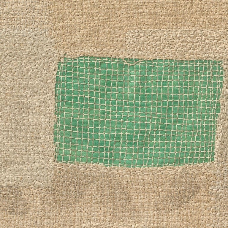 Reclaimed linen, bookcloth from discarded library books by Ernest Hemingway, stencils, thread, and mull.
