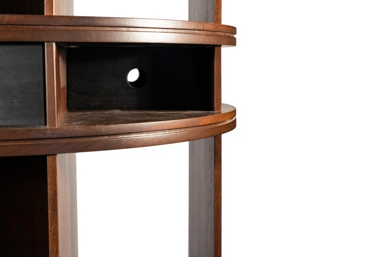 Joe Colombo, Bookcase, Torre Comby center, Edition Bernini, Wood and steel, Italy, circa 1960.  Measures: Height 182.5 cm, diameter 82.5 cm.