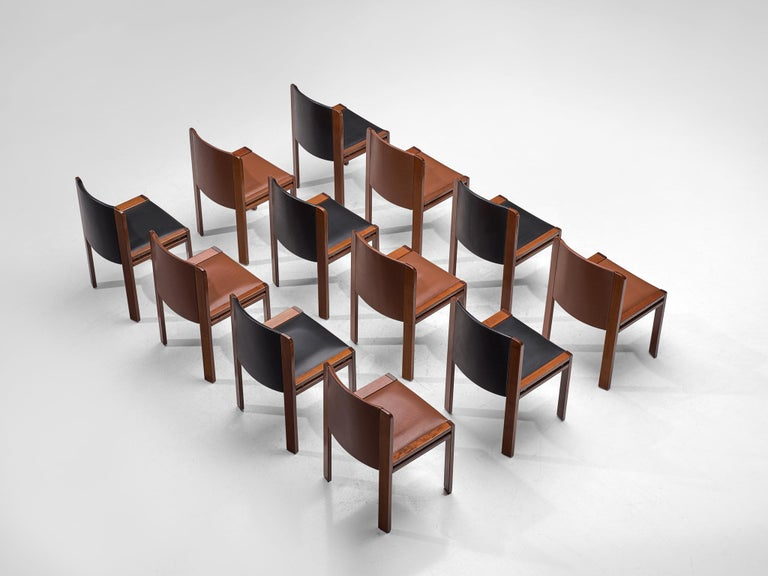 Joe Colombo for Pozzi, 12 dining chairs model '300', leather and oak, Italy, 1966.  This functionalist set of dining chairs is designed by Joe Colombo in 1966. His fascination with functionality meant he always focused on the user, which lead him
