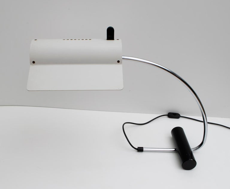 Lamp designed by Joe Colombo, in ivory lacquered aluminum and structure in chromed and black metal.