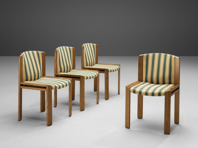 Joe Colombo for Pozzi, set of four dining chairs '300', fabric, oak, Italy, 1966  Functionalist set of four dining chairs is designed by Joe Colombo in 1966. Colombo's fascination with functionality meant he always focused on the user, which lead