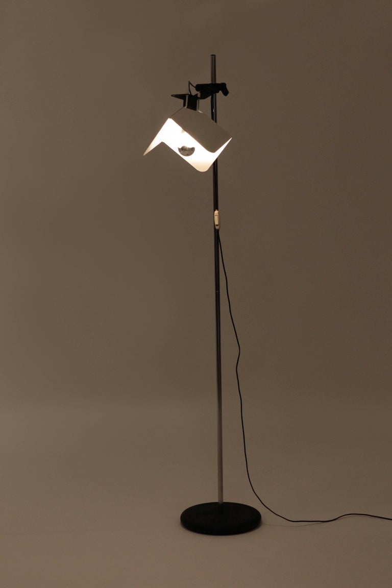 """Joe Colombo """"Triedro"""" floor lamp manufactured by Stilnovo in the 1970s in Italy. Adjustable, white lacquered metal shade attached with a joint to a chrome steel pole."""
