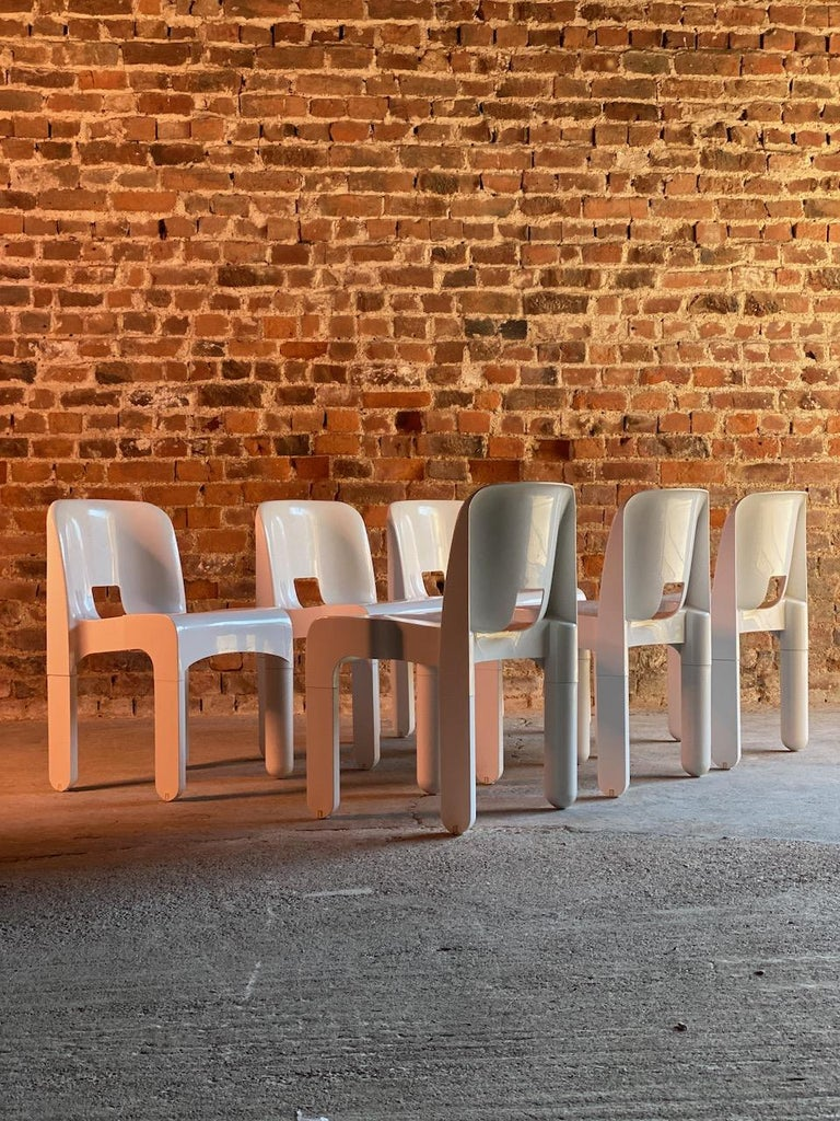 Joe Colombo Universale chairs set of six by Kartell, Italy, 1967  Rare opportunity set of six Joe Colombo model 4867 Universale chairs by Kartell, Italy circa 1967 in polycarbonate and Produced by Kartell, Noviglio, Milano. The chairs all stamped