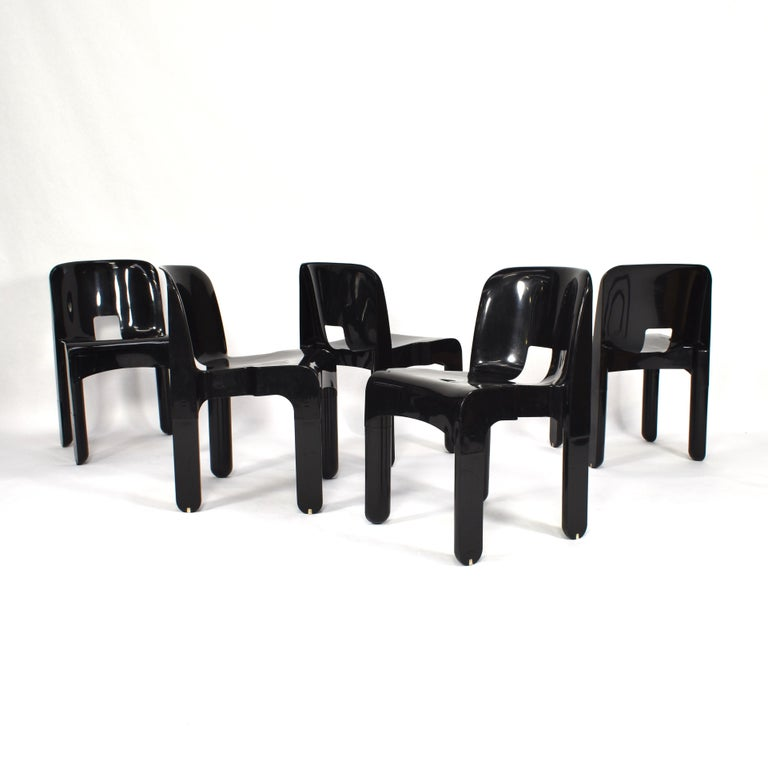 Joe Colombo model 4867 Universale stacking chairs. The chairs can be stacked by three chairs maximum.  Designer: Joe Colombo  Manufacturer: Kartell  Country: Milan, Italy  Model: 4867 Universale stacking chair  Material: Plastic /