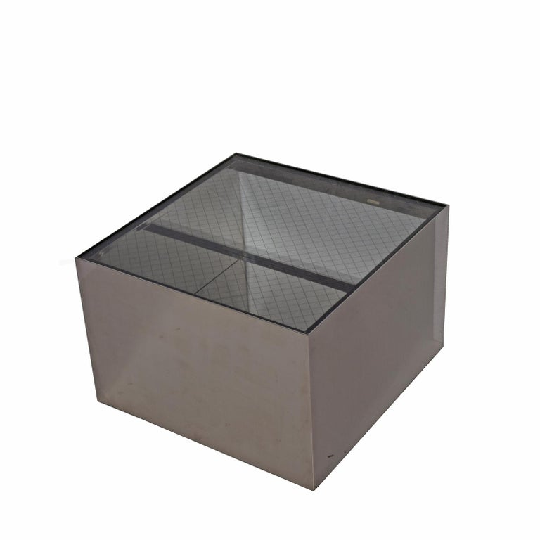 Low stainless steel rolling table with wire glass top design in 1980 original partial paper label,