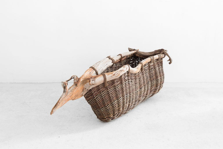 Bog Boat Going To Ground Manufactured by Joe Hogan Produced in exclusive for SIDE GALLERY Ireland, 2020 Bog pine(roots of pine trees which had been covered with peat for 3000 yeas) and willow rods, variety Harrisons  Measurements 97 cm x 36