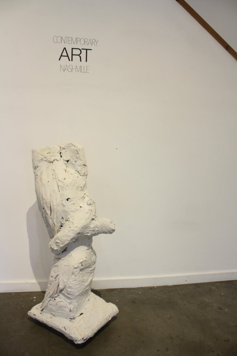 White abstract sculpture made out of paint, paper, wood, metal, plastic, tape, fabric, clothing, and caulking.  Artist Statement:   Painting is meditative. Not every action needs to be planned, articulated or resolved. There is a connection between